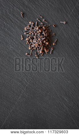 Cloves On A Black Slate Table