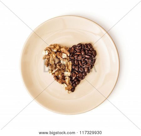 Shape Heart Of Coffee Beans And Peeled Walnuts On The Plate, Valentine's Day