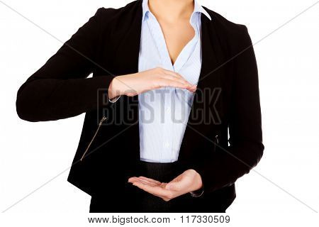 Business woman holding empty copy space between her hands