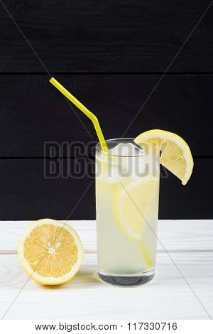 Lemon Cocktail With Ice And Segments Of A Lemon