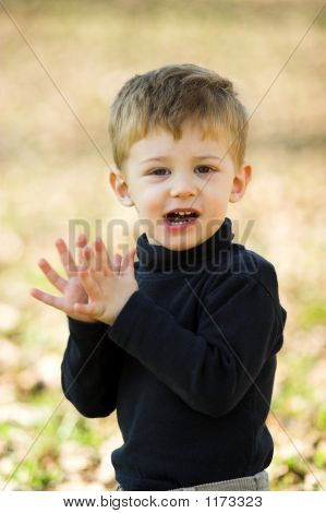 A Little Boy Clapping