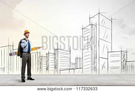 Architect designer with huge pencil