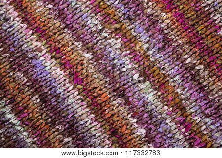 wool macro purple and red handmade textile