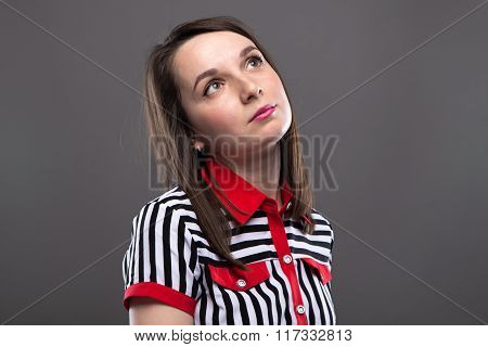 Young brunette woman looking up