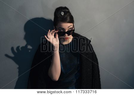 Stylish Wealthy Asian Woman In Retro 40S Fashion With Sunglasses. Looking Over Sunglasses.