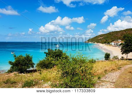 Idyllic tropical Turners beach with white sand, turquoise ocean water and blue sky at Antigua island in Caribbean