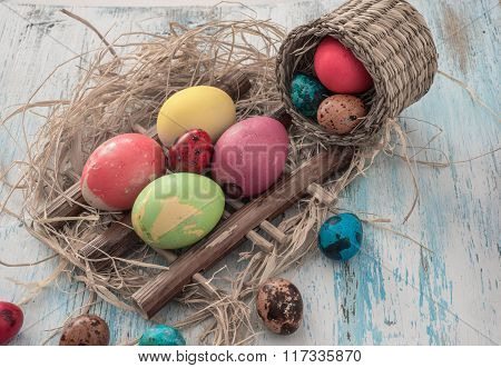 Happy Easter Multi-colored Eggs On Wooden Bacground