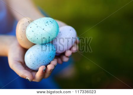 Close up of little girl holding colorful Easter eggs