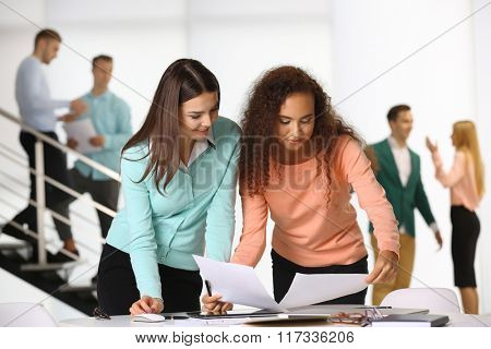 Two businesswomen working in a conference room