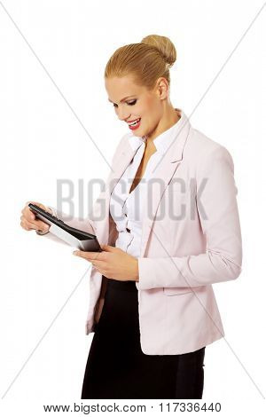 Smile business woman holding calculator