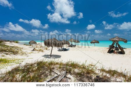 Tropical thatch umbrellas on a beautiful Caribbean beach
