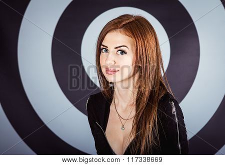 Girl in front of target background
