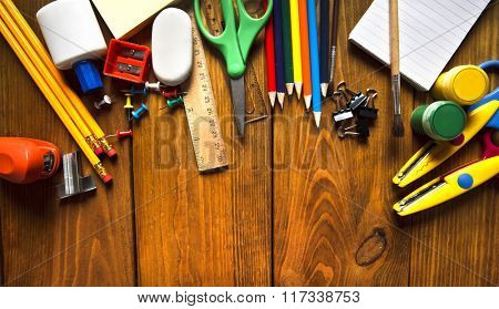 School equipment on wooden desk