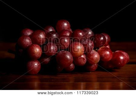 Grapes on wooden table, studio picture