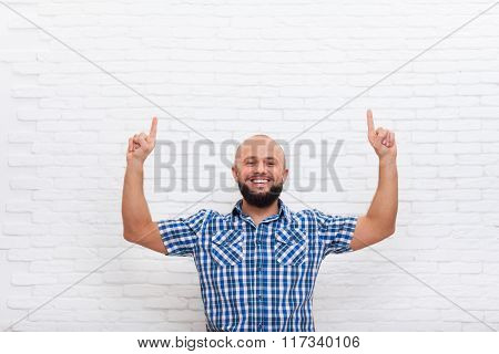 Casual Bearded Business Man Smiling Point Fingers Up To Copy Space