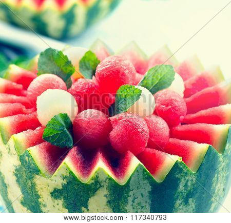 Watermelon. Fruit Salad. Fresh and Ripe Watermelon and Melon Balls with Mint