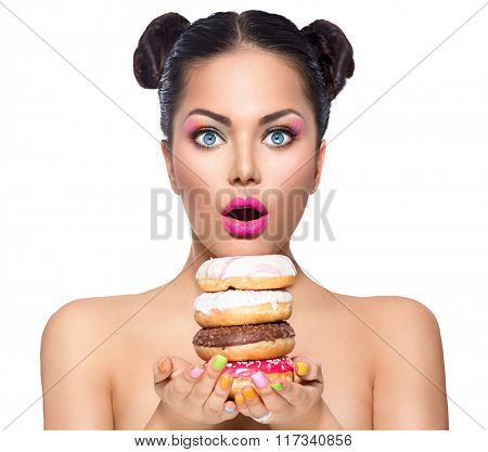 Beauty fashion model girl taking stack of colorful donuts and muffin. Funny joyful woman with sweets, dessert. Diet, dieting concept. Junk food, Slimming, weight loss. Isolated on white background