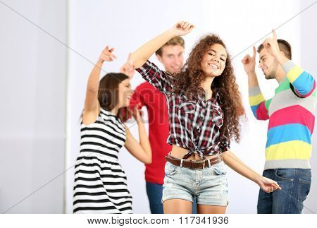 Teenager girl dancing with her friends