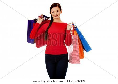 Young happy smiling woman holding shopping bags