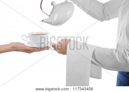 Waiter pouring tea to customer in cup isolated on white