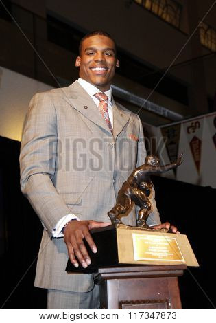 NEW YORK-DEC 11: Cam Newton, quarterback of the Auburn University Tigers, poses with the 2010 Heisman Memorial Trophy Award on December 11, 2010 in New York City.