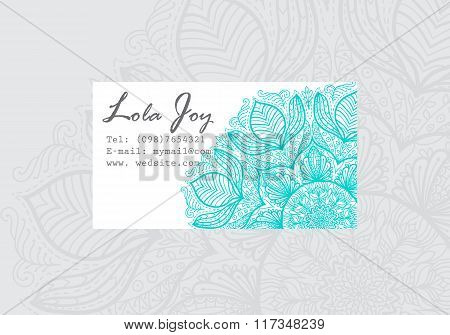 Business card template with round turquoise mandala