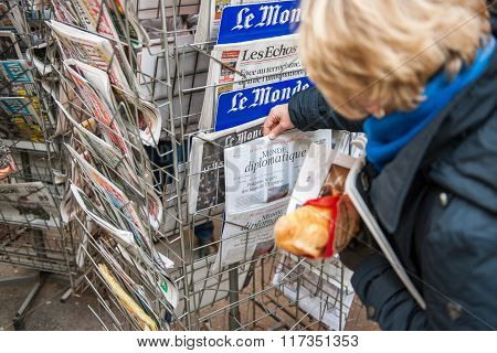 French Woman Buying Political Magazine