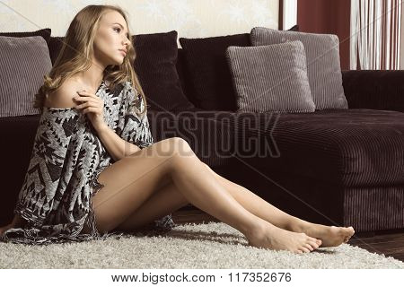 Girl Sitting At Home On Carpet