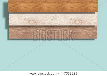 Three Different Wood Planks On Blue Background