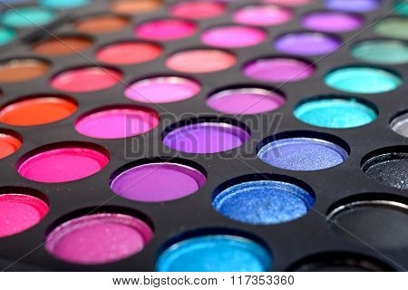 Colourful eye shadows and make-up palette close-up