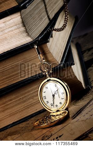 Vintage Pocket Clock And Old Books