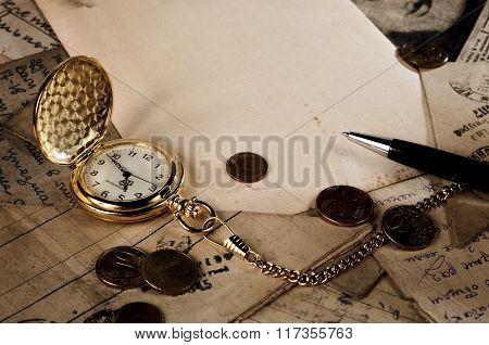 Vintage Pocket Clock, Pen And Money On Old Letters Texture