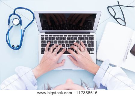 Female Doctor Hands Working On Laptop