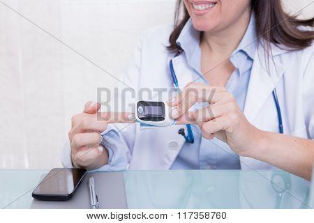 Medic Showing Finger Pulse Oximeter