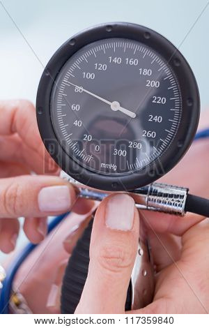 Woman Hands Holding Manometer