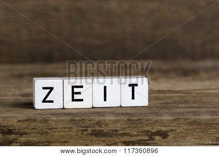 The German Word Time Written In Cubes