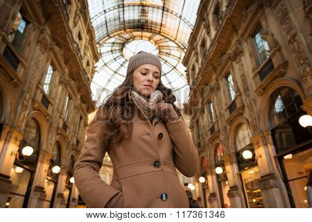 Pensive Young Woman Standing In Galleria Vittorio Emanuele Ii