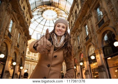 Woman In Galleria Vittorio Emanuele Ii Showing Thumbs Up