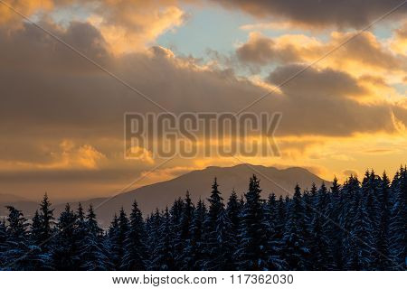 Dramatic Colorful Sunset In The Winter Mountains