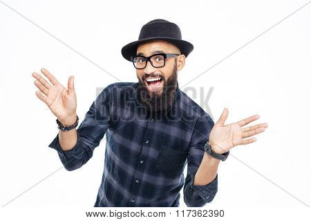 Happy successful young bearded african man in black hat and glasses