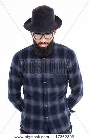 Portrait of handsome bearded african man in black hat and glasses