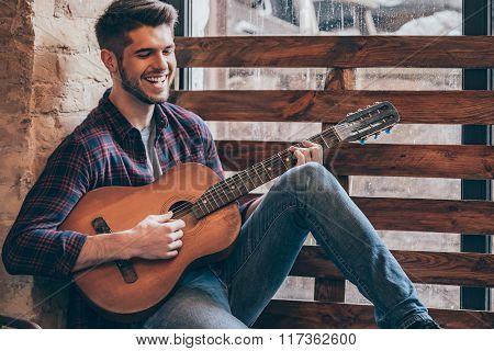 Cheerful Guitarist.