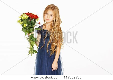 Beautiful little girl with a bouquet of flowers