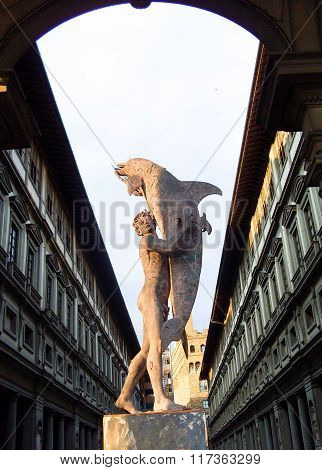 Man with dolphin, Clock Tower of Palazzo Vecchio and Uffizi Gallery, Florence, Italy