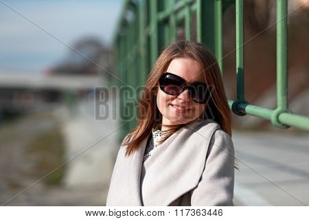 Young woman with sunglasses and coat