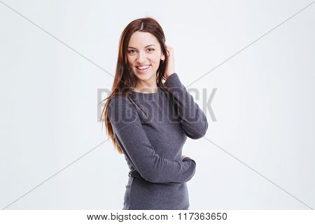 Happy businesswoman standing isolated on a white background