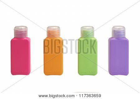 Four Multicolored  Small Plastic  Bottle Isolated On White