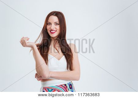 Smiling young woman looking at camera isolated on a white background