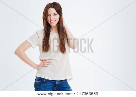 Portrait of cheerful lovely young woman posing over white background