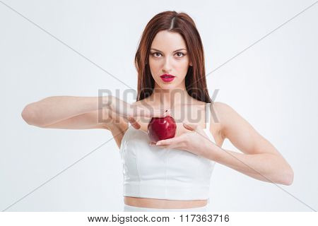 Beautiful woman holding red apple isolated on a white background